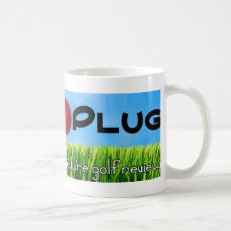 Putten pluggar muggen kaffemugg
