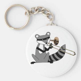 Raccoon som leker trombonen rund nyckelring