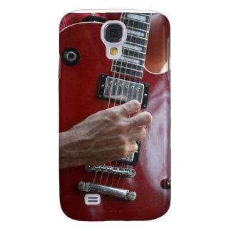 Räcka att leka den röda elektriska gitarren nära u galaxy s4 fodral