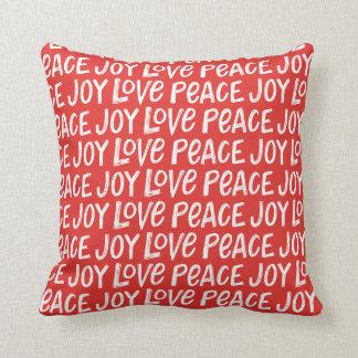Räcka märkt glädjefred den röda juldekorativ kudde