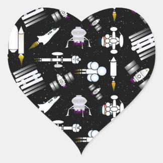 Raket- och Spaceshipmönster i stjärnor Hjärtformat Klistermärke