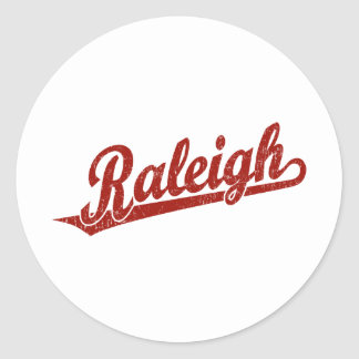 Raleigh skrivar logotypen i rött bekymrat runt klistermärke