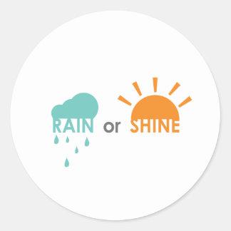 Regna eller sken runt klistermärke