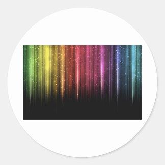 Regna regnbågestjärnor runt klistermärke