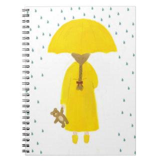 Regnig dagflicka med nalleanteckningsboken anteckningsbok