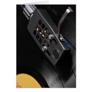 Rekord- leka för vinyl på en turntable hälsningskort