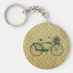 Retro grön cykel med blommabasketen nyckel ringar
