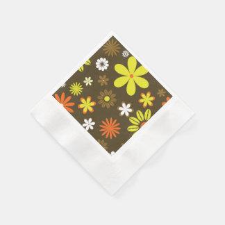 Retro gult och orangen blommar på brunt pappersservett