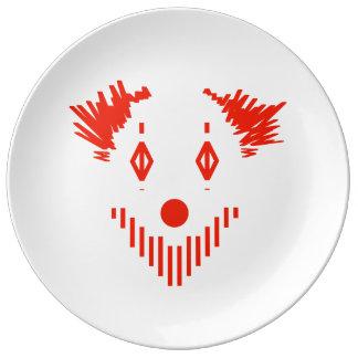 Röd clown porslinstallrik