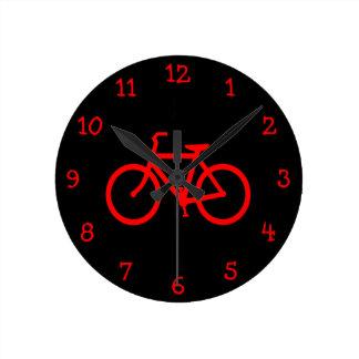 Röd cykel rund klocka
