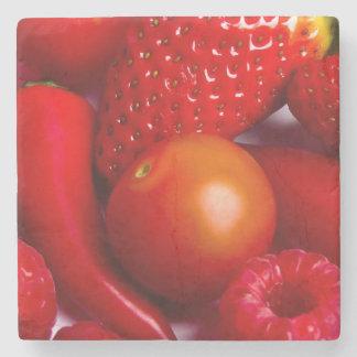 Röd frukt-/grönsakstenkustfartyg underlägg sten