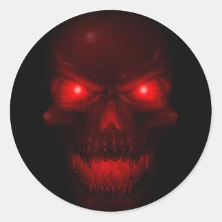 Röd glödande skalle rund klistermärke