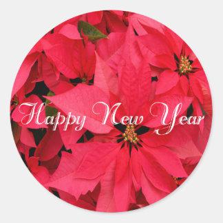 Röd gott nytt år för julstjärnablommablommigt runt klistermärke