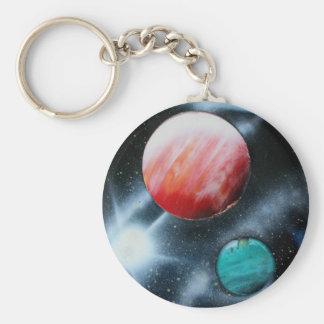Röd grön planet- och vitstjärna som spraypainting rund nyckelring