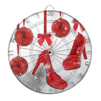 Röd högklackar och julbollar och rött band piltavla