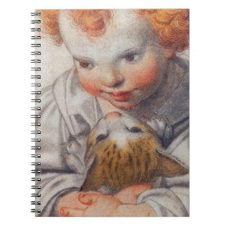 Röd-hövdat barn med katten anteckningsbok med spiral