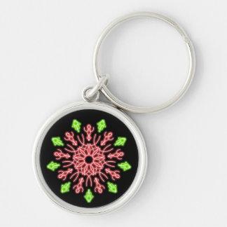 Röd och grön neonblomma rund silverfärgad nyckelring