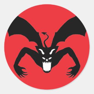 Röd och svart djävulen runt klistermärke