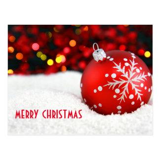 Röd prydnad Bokeh för god jul Vykort