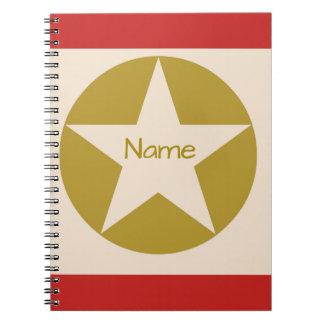 Röd solbränna- och guldstjärna i ett cirklanamn anteckningsbok med spiral