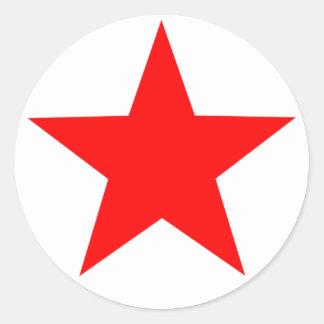 Röd stjärnarundaklistermärke runt klistermärke