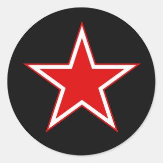 Röd stjärnasvartklistermärke runt klistermärke
