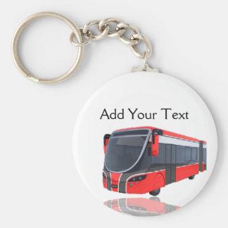 Röd vit och svart buss på vit rund nyckelring
