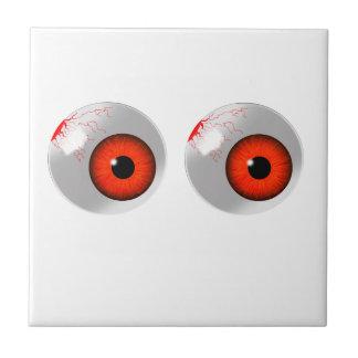 röda ögonglober liten kakelplatta