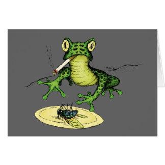 Röka grodan med en plätera av flugan hälsningskort