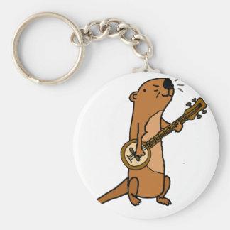 Rolig havsutter som leker banjoen rund nyckelring
