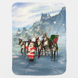 Rolig jultomten med renen och sleighen