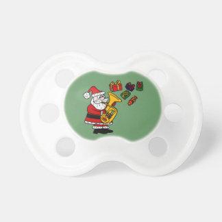 Rolig jultomten som leker Tubajulkonst Napp