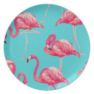 Rosa flamingofåglar på turkosbakgrund tallrik