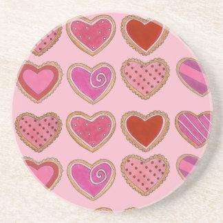 Rosa frostade valentin för hjärtakakakärlek dag underlägg sandsten