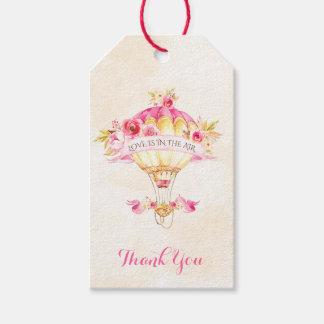 Rosa guld- gul rospil för luftballong presentetikett