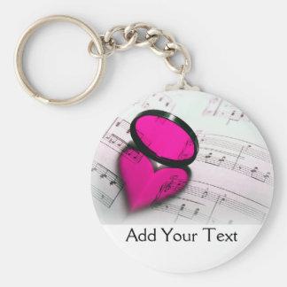 Rosa hjärtareflexion på notblad rund nyckelring