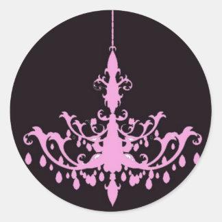 Rosa ljuskrona på svart klistermärke