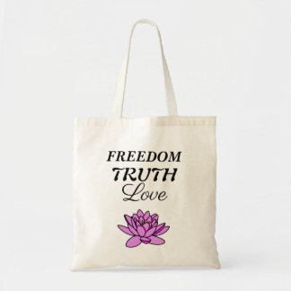 Rosa lotusblommar hänger lös - frihet, sanning, tygkasse