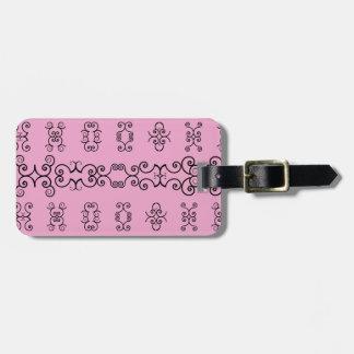 Rosa och svart bagagemärkre bagagebricka