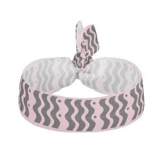 rosa och svart hårprydnad hårband