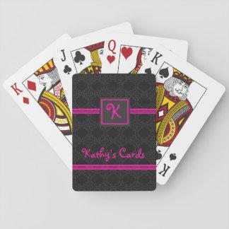 Rosa och svart personlig som leker kort spel kort