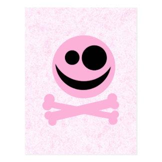 Rosa och svart skalle, på en rosa modell vykort