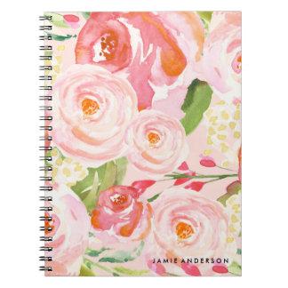 Rosa rosblommigtanteckningsbok anteckningsbok med spiral