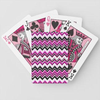 Rosa sparre som leker kort spelkort