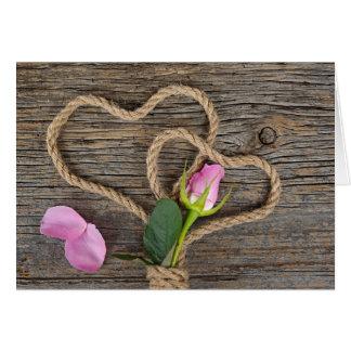 Rosa valentin och rephjärtor hälsningskort