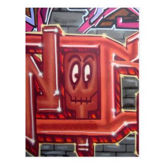 Rött grafittiansikte vykort