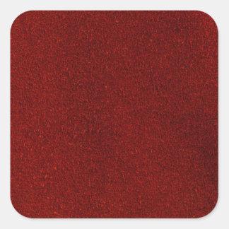 Rött läder fyrkantigt klistermärke