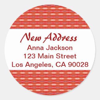 Rött nytt adress runt klistermärke