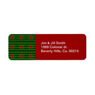 Rött omkullkasta lika julstjärnor på grönt returadress etikett