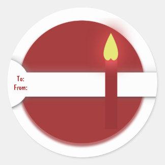Rött stearinljus för julgåvamärkre runt klistermärke